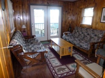 A spectacular view of Beautiful Portage Lake awaits you in Cabin #11.