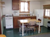 The kitchen in Cabin #13 has modern appliances.