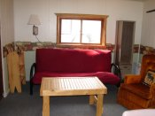 The livingroom in Cabin #13 has a twin bed for extra sleeping capacity or for just lounging around.