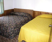 The master bedroom in Cabin #14 has two double beds.