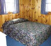 The first bedroom in Cabin #17 has a double bed.