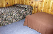 The third bedroom in Cabin #17 has a double bed and a twin bed.