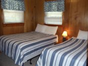 The second bedroom in Cabin #2 has two double beds.
