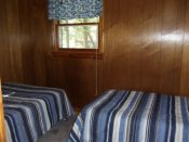 The third bedroom in Cabin #2 has a double bed and a twin bed.