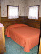 The first bedroom in Cabin #4 has a double bed.