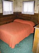 The second bedroom in Cabin #4 has a double bed.