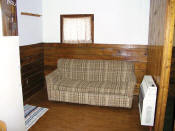 The livingroom in cabin #4 is a great place to relax with a good book.