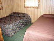 The second bedroom in Cabin #8 has a double and a twin bed.
