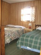 The first bedroom in Cabin #8 has a double and a twin bed.