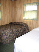 The second bedroom in Cabin #9 has a double bed and a twin bed.